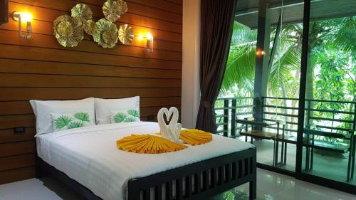 A bed or beds in a room at Rin Beach Resort