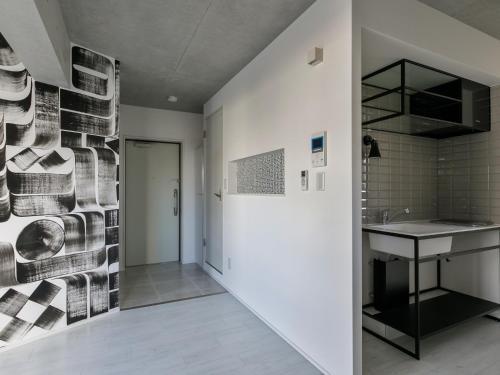 A kitchen or kitchenette at AOCA KAMINOGE 302