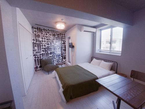 A bed or beds in a room at AOCA KAMINOGE 401