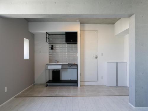 A kitchen or kitchenette at AOCA KAMINOGE 401
