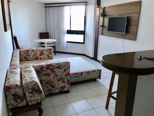 Uma área de estar em Flat Vista Mar em Ótima Localização na Pituba