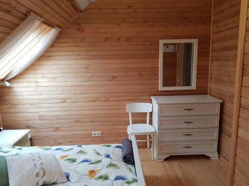 Gulta vai gultas numurā naktsmītnē Guest House Ziedkalni