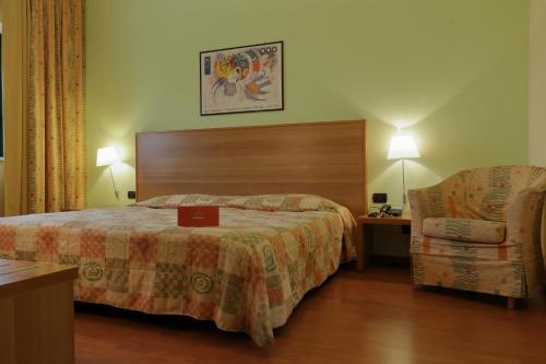 Letto o letti in una camera di Hotel Romanisio