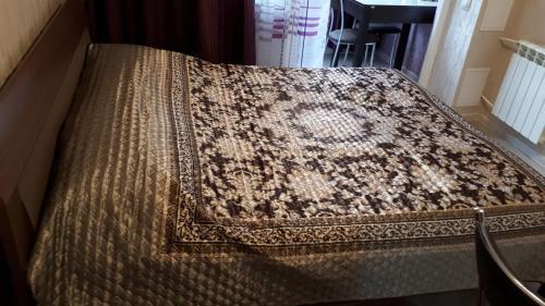 Кровать или кровати в номере Apartamenty u Tatiany na Svetlane