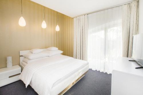 Łóżko lub łóżka w pokoju w obiekcie Hotel Inter