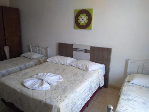 A bed or beds in a room at Hotel Oldoni