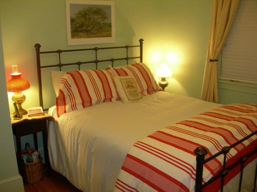 A bed or beds in a room at Comfort Found Literary Lodging