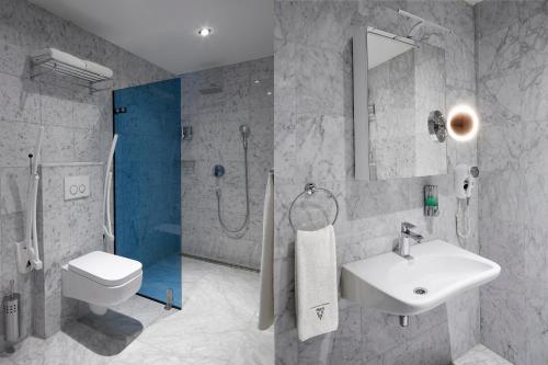 Een badkamer bij Amadi Park Hotel