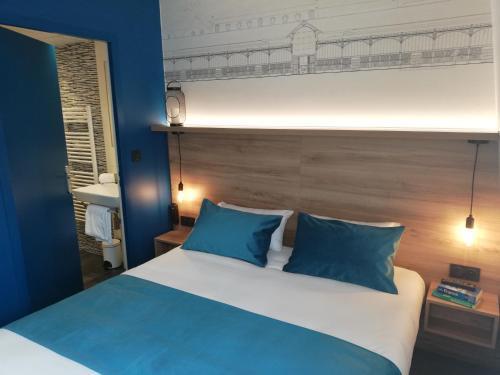 Un ou plusieurs lits dans un hébergement de l'établissement Hôtel des Halles