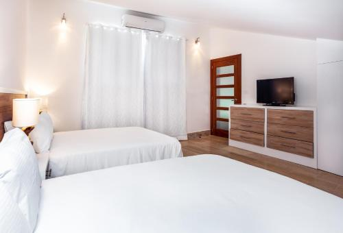 Un ou plusieurs lits dans un hébergement de l'établissement Apartment in Sublime Samana Resort