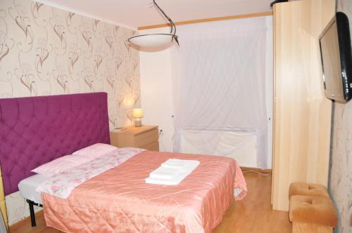 Łóżko lub łóżka w pokoju w obiekcie Luna Apart Gdańsk