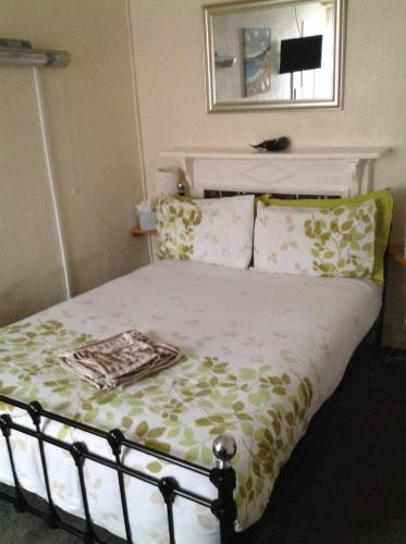 A bed or beds in a room at The Rolle Quay Inn