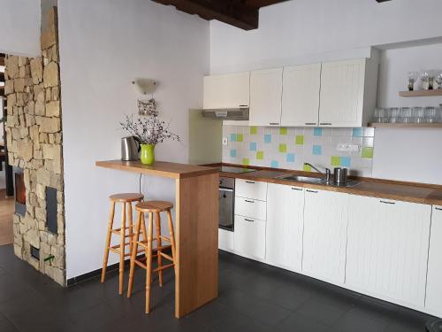 Kuchyň nebo kuchyňský kout v ubytování Chata Moja