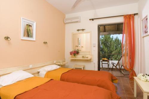 Ένα ή περισσότερα κρεβάτια σε δωμάτιο στο Nautilus Barbati
