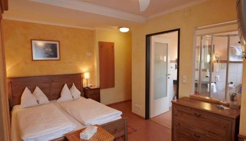 Ein Bett oder Betten in einem Zimmer der Unterkunft Itzlingerhof Rooms