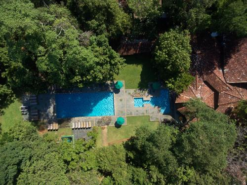 A view of the pool at Hotel Sigiriya or nearby