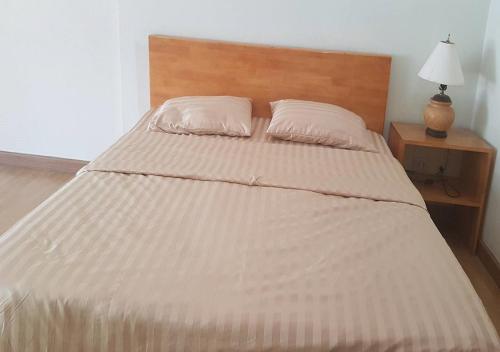 Кровать или кровати в номере Smile House