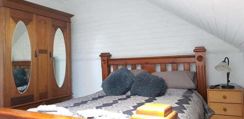 A bed or beds in a room at Barrington Church B&B