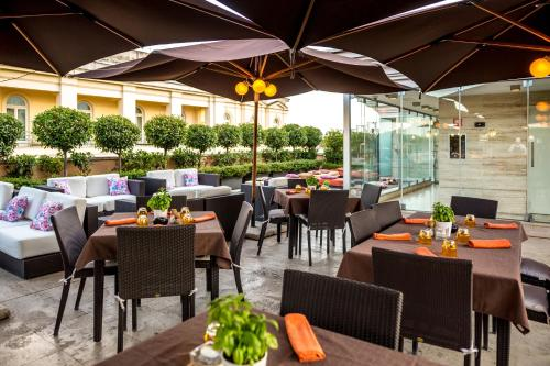 Een restaurant of ander eetgelegenheid bij Grand Hotel Via Veneto
