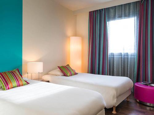 Un ou plusieurs lits dans un hébergement de l'établissement Hôtel Provence