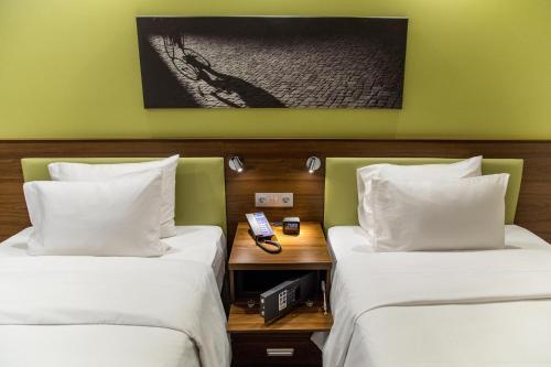 Кровать или кровати в номере Hampton by Hilton Brest