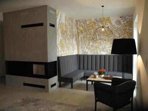TV a/nebo společenská místnost v ubytování penzion rustico s.r.o.