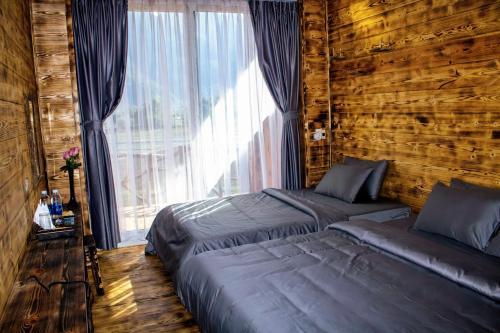 Un ou plusieurs lits dans un hébergement de l'établissement Mai Chau Countryside Homestay