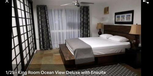 A bed or beds in a room at La Casa De Playa