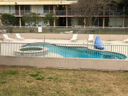 The swimming pool at or near Super 8 by Wyndham Baton Rouge/I-10