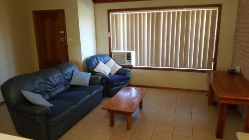A seating area at Scone Villas-Villa 2