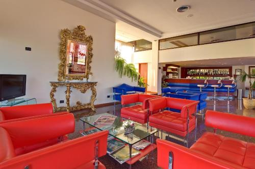 The lobby or reception area at Recina Hotel