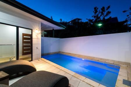 The swimming pool at or near Central & Private, Stunning Water Views, Pool & BBQ
