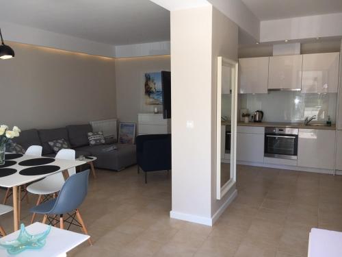 Kuchnia lub aneks kuchenny w obiekcie Balticsand Apartament