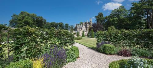 A garden outside Turnhouse Chateau Sleeps 24 WiFi