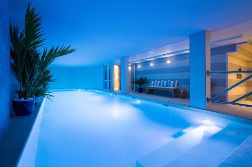 The swimming pool at or near Jardins de Mademoiselle Hôtel & Spa