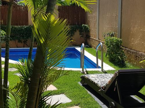 A piscina localizada em Pipa Beleza Spa Resort V7 ou nos arredores