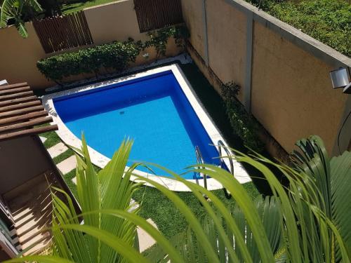 Uma vista da piscina em Pipa Beleza Spa Resort V7 ou nos arredores