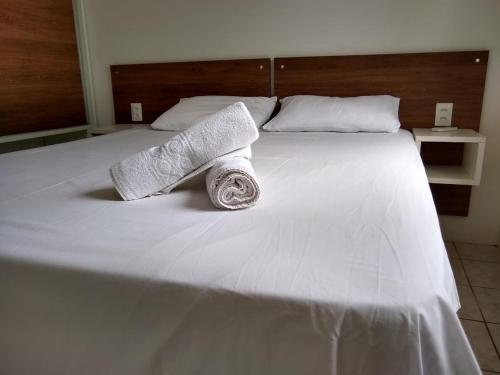 A bed or beds in a room at Residencial Lorenzi