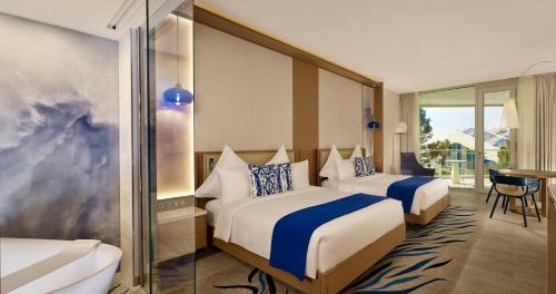 A bed or beds in a room at Paragraph Resort & Spa Shekvetili, Autograph Collection