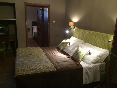 Letto o letti in una camera di La Rocca Guest House & Spa