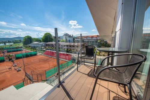 Balkón alebo terasa v ubytovaní AQUA SPORT***