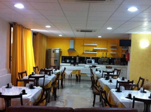 A restaurant or other place to eat at OUMAYA SAFA