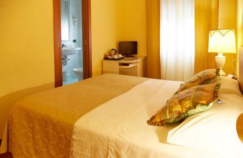 Letto o letti in una camera di Casa Villa Gardenia