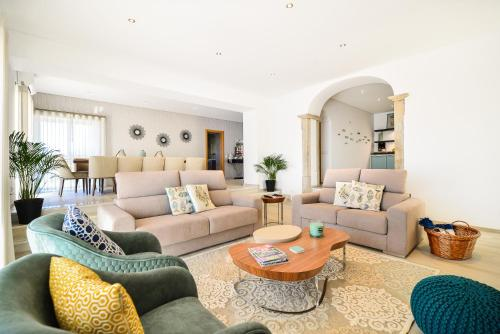 A seating area at Vila Vale Mouro by OCvillas