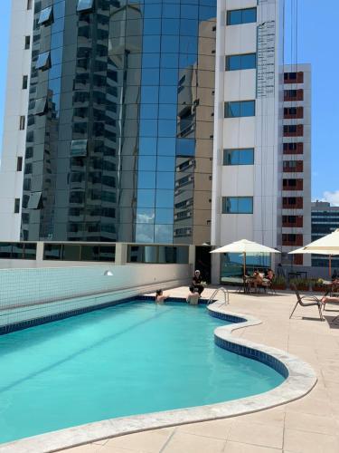 The swimming pool at or near Beach Class Executive Apartamento