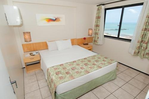 A bed or beds in a room at Iracema Travel