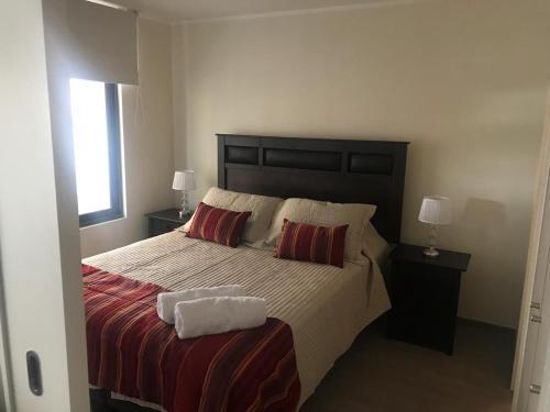 Cama o camas de una habitación en Live San Martín