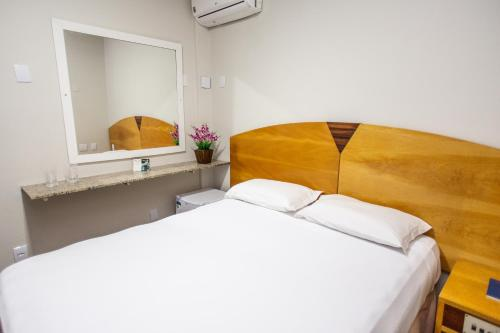 A bed or beds in a room at Panorama Convention Hotel
