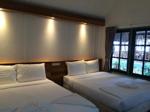 Ein Bett oder Betten in einem Zimmer der Unterkunft Apple Beachfront Resort