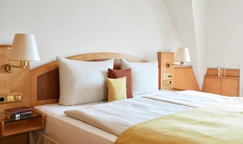 Cama o camas de una habitación en Living Hotel Großer Kurfürst
